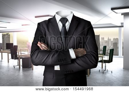 businessman without head in modern office crossed arms