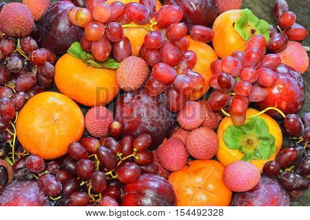 still life with variety of fruits and berries as fruit background