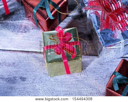 close up view  of  gift boxes on snowbound  wooden back
