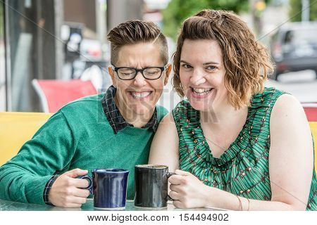 Laughing Couple Outdoors In Green Dress And Sweater