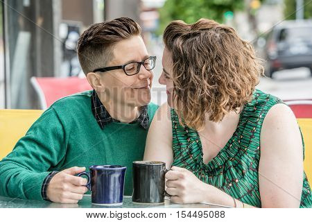 Romantic Lesbian Couple At Bistro Outdoors