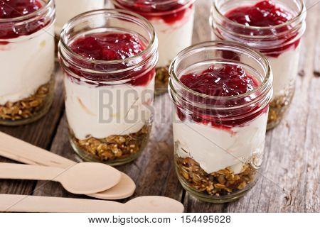 Autumn granola parfait with yogurt and cranberry jam