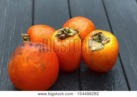 persimmon Fresh ripe persimmon on wooden table fruits on rustic table tropical fruit