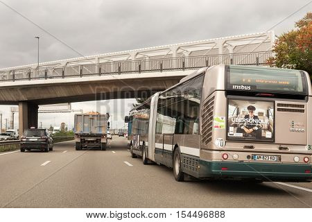 STRASBOURG FRANCE - OCT 20 2016: Public bus with Uber Advertising on it driving on busy French highway - driver point of view