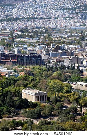 a view of the Temple of Hephaestus and Athens city beyond