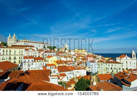 Lisbon Portugal old town skyline at the Alfama with orange rooftops