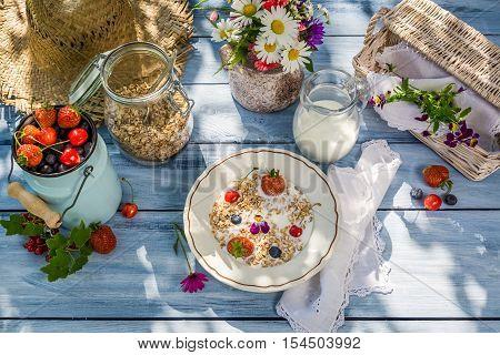 Summer breakfast in the garden on old wooden table