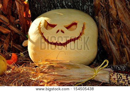 Pittsboro North Carolina - October 30 2016: A carved jack-o-lantern with eerie smile at the annual Fearrington Village Halloween event
