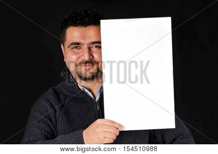Young man holding blank sign All on black background