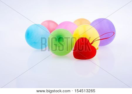Red Heart And Colorful Small Balloons