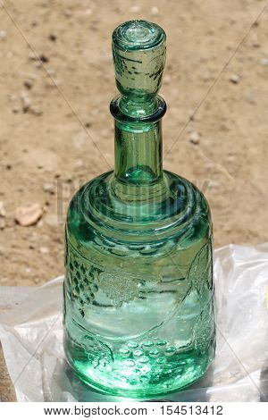 Green glas jug in oriental style in antique market