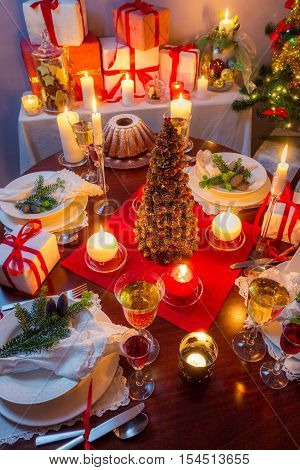 Dinning room at Christmas Eve with gifts and candles