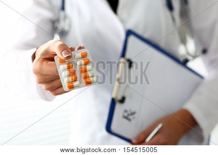Female Doctor Hand Hold Prescription On Clipboard Pad
