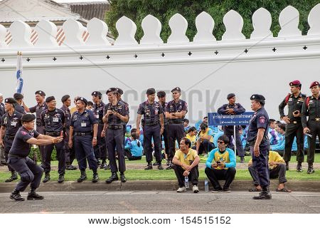 Bangkok, Thailand - December 5, 2015: Unidentified policemen pose for a photo before the start of the procession on celebrating of the King Rama 9 birthday at the walls of the Grand Palace Bangkok Thailand.