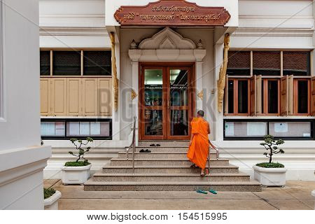 Bangkok, Thailand - December 7, 2015: Monk goes up the stairs of office building of Maha Chulalongkon Ratcha Witthayalai University. It is one of two public Buddhist universities in Thailand.