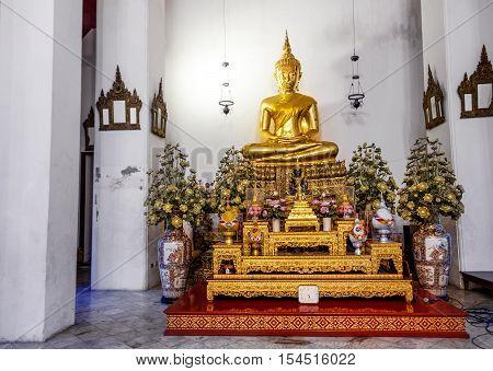 Bangkok, Thailand - December 7, 2015: Big Golden Buddha image inside the hall of Wat Pho public temple Bangkok Thailand.