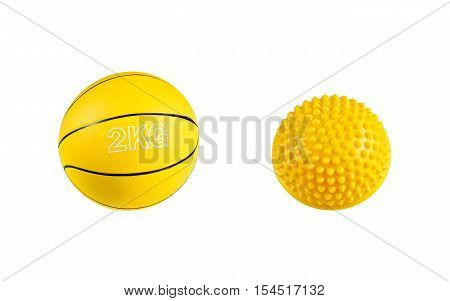 Yellow medicine ball and balance training equipment for fitness and rehabilitation isolated on white background