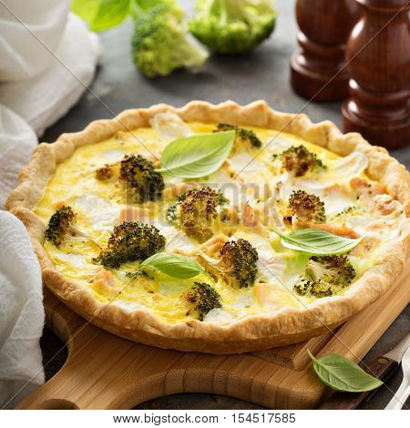 Healthy vegetable and salmon quiche with broccoli and basil