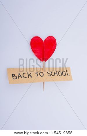 heart shape with a title back to school on a white background