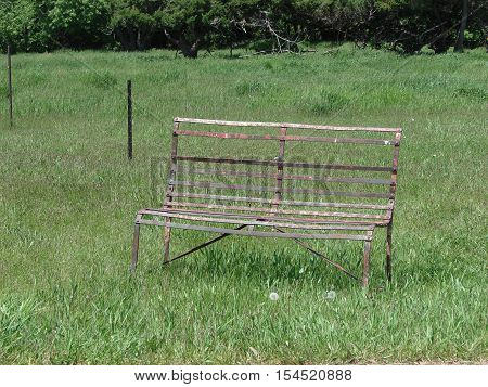 An old abandoned steel bench without cushions.