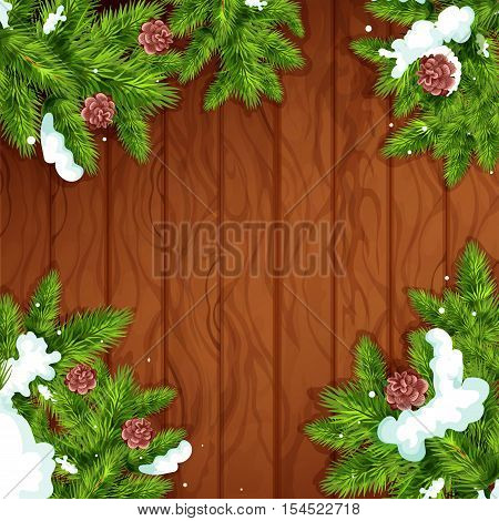 Christmas wooden background. Fir and pine green branches with snow and cone on wooden plank background with copy space. Christmas tree frame for greeting card design