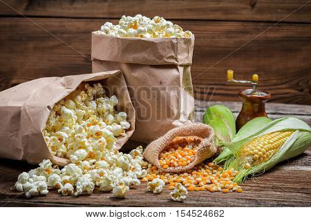 Rustic popcorn and corn on old wooden table