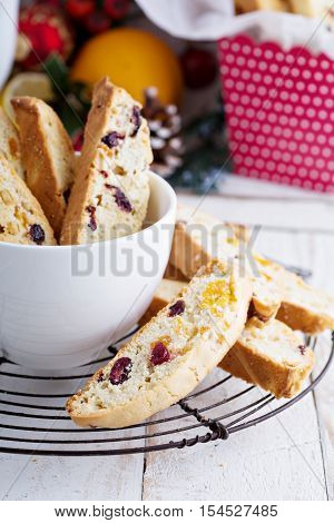 Christmas biscotti with fruits and nuts in a big cup