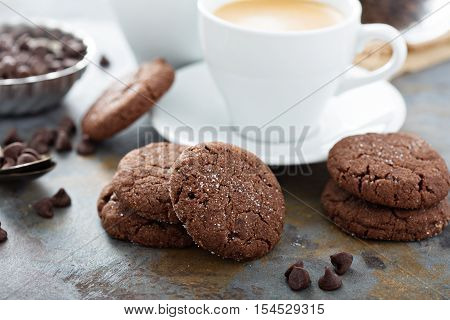 Chocolate cookies with sugar coating and a cup of coffee