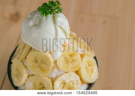 Korean style bing su fresh banana shaved ice on wood table