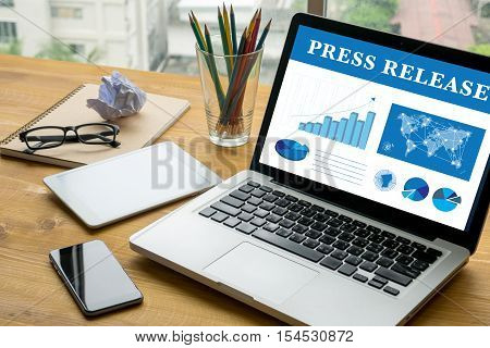 Press Release Laptop on table. Warm tone poster