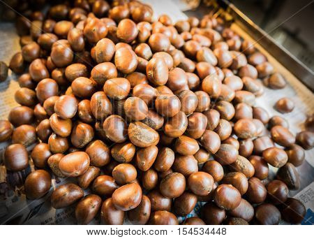 a bunch of fried chestnut become brown color and ready to eat.