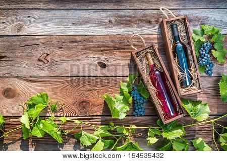 Different Types Of Wine In A Wooden Box And Grapes