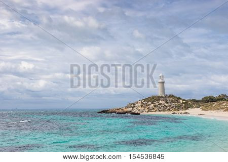 Cloudy skies over Pinky Beach and Bathurst Lighthouse at Rottnest Island near Perth in Western Australia.
