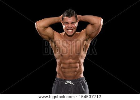 Young Bodybuilder Flexing Muscles Isolate On Black Blackground