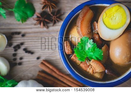 Eggs and pork in brown sauceThai Cuisine Boiled eggs with chicken drumstick in sweet gravy.Eggs and pork in brown sauce chinese braised soy sauce eggs
