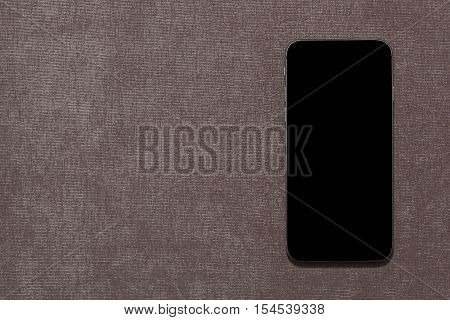 iPhone 6 front view lying on white background. iPhone 6 is the latest model of successful dynasty of smartphones