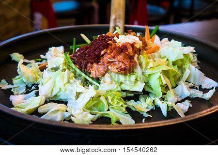 One of Korean favorite : Korean spicy stir fried vegetable, chicken and Korean spicy sauce (Gochujang) in big hot pan know as Dak Galbi poster