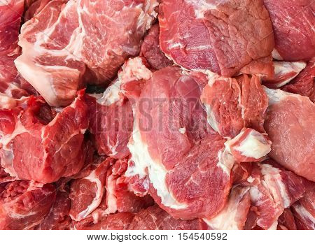 Lot of CheapFresh Red Beef on sale. Fresh Cow meat beef are cut in small pieces for pick up in supermarket. These are cheap cow beef that grown in Thai farm. Beef are favorite by local muslims.