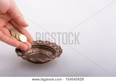 Hand Giving Money To  A Bowl