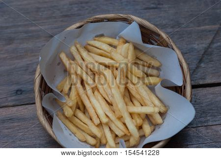 Close up of a plate of french fries.