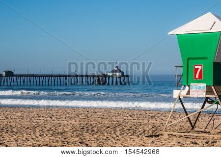 Imperial Beach fishing pier with lifeguard tower on beach in San Diego, California.