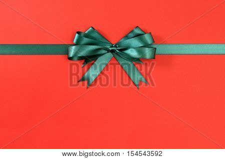 Green Gift Ribbon Bow Straight Horizontal Red Paper Background