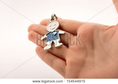 Man shaped keyholder in hand on white background