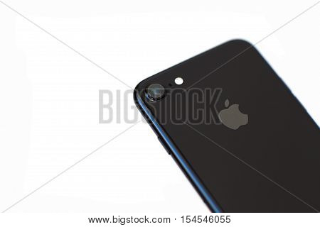 Alushta Russia - October 29 2016: New iPhone 7 in isolated background. iPhone 7 Jet Black was created and developed by the Apple inc.