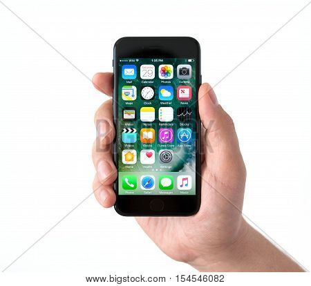 Alushta Russia - October 29 2016: Isolated man hand holding iPhone 7 Jet Black with IOS 10 in the screen. iPhone 7 was created and developed by the Apple inc.