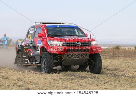 Close-up View Of Speeding Red And Black Toyota Hilux Twin Cab Rally Car