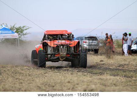 Speeding Orange Bat Rally Car Front View