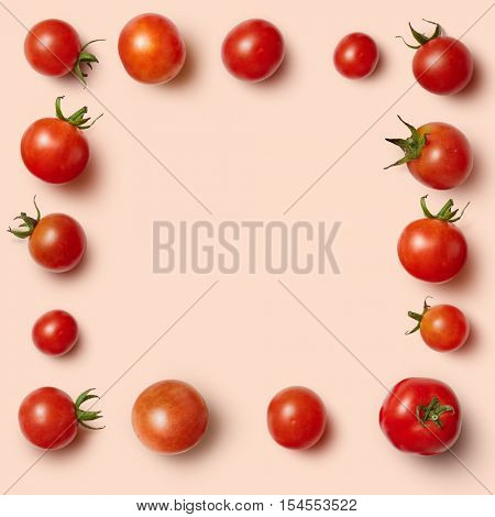 The rectangular frame of cherry tomatoes isolated on a pink background. Unusual place for text about cooking, nutrition, healthy lifestyles, Italian food, organic food, etc.