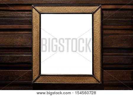 Rattan wicker wooden picture frame. rattan wicker wooden wall mirror decorate, on hardwood wall, isolated on white background
