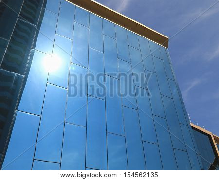 Perspective And Underside Angle View To Textured Background Of Modern Glass Building Skyscrapers At